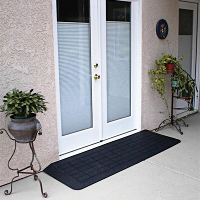 A double door size threshold ramp for scooters and wheelchairs
