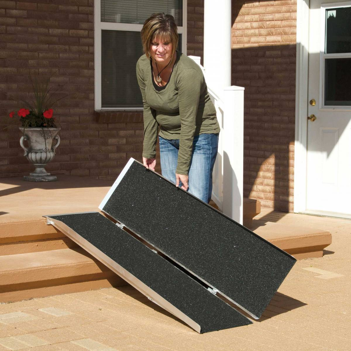 Woman folding up her wheelchair ramp for travel