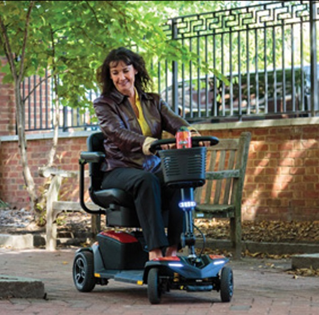 Woman riding mobility scooter